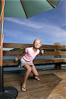 preteen dancing - Girl (10-11 years) crouching on wooden deck, portrait Stock Photo - Premium Royalty-Freenull, Code: 6106-07023187