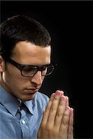 Young man praying, close-up Stock Photo - Premium Royalty-Freenull, Code: 6106-07023223