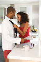 Young couple flirting in kitchen Stock Photo - Premium Royalty-Freenull, Code: 6106-07024076