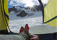 Hiker's feet in tent on glacier (personal perspective) Stock Photo - Premium Royalty-Freenull, Code: 6106-07024093