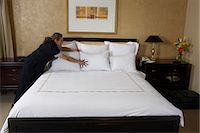services - Maid making double bed in hotel room Stock Photo - Premium Royalty-Freenull, Code: 6106-07024181