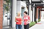 Two women talking in street Stock Photo - Premium Royalty-Free, Artist: Blend Images, Code: 6106-07024229