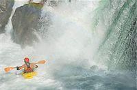 Whitewater kayaker paddling under waterfall Stock Photo - Premium Royalty-Freenull, Code: 6106-07024252