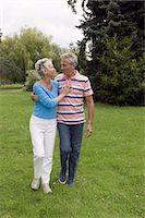Mature couple walking in park Stock Photo - Premium Royalty-Freenull, Code: 6106-07024728