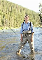 Portrait of young woman with fishing rod outdoors Stock Photo - Premium Royalty-Freenull, Code: 6106-07025483