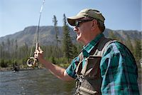 fishing - Senior man flyfishing Stock Photo - Premium Royalty-Freenull, Code: 6106-07025497