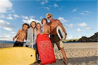 shirtless men - Man and four boys (8-13) with body boards and surfboard, on beach,  portrait Stock Photo - Premium Royalty-Freenull, Code: 6106-07026051