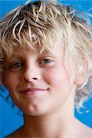 Portrait of blonde boy (12-13), studio shot Stock Photo - Premium Royalty-Freenull, Code: 6106-07026344
