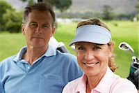 Mature couple on golf course, portrait, close up Stock Photo - Premium Royalty-Freenull, Code: 6106-07026386