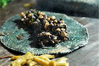 A quesadilla made with a blue corn tortilla with huitlacoche (corn fungus, Mexico) Stock Photo - Premium Royalty-Freenull, Code: 659-07026791