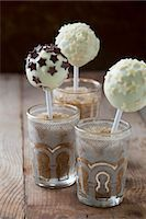 popping (bursting not corks or pimples) - Cake pops with white chocolate icing and chocolate stars Stock Photo - Premium Royalty-Freenull, Code: 659-07026962
