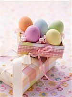 An Easter parcel and brightly coloured eggs for Easter Stock Photo - Premium Royalty-Freenull, Code: 659-07027223