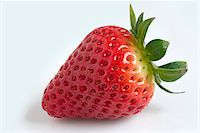 strawberries - A strawberry against a white background Stock Photo - Premium Royalty-Freenull, Code: 659-07027517