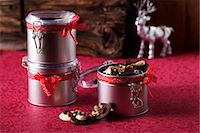 reindeer in snow - A tin of chocolate buttons for Christmas Stock Photo - Premium Royalty-Freenull, Code: 659-07028441
