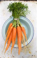 Fresh Bunch of Carrots in a Blue Bowl Stock Photo - Premium Royalty-Freenull, Code: 659-07028649