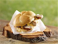 Bread roll filled with sauerkraut, grilled bratwurst and sausages Stock Photo - Premium Royalty-Freenull, Code: 659-07028749