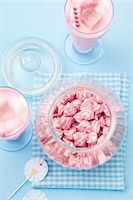 A jar of pink and white striped sweets, and a strawberry milkshake with marshmallows Stock Photo - Premium Royalty-Freenull, Code: 659-07028854