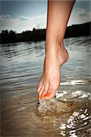 female feet close up - foot coming out of the water Stock Photo - Premium Royalty-Freenull, Code: 6106-07030102
