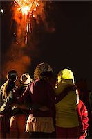 Group of people watching firework display Stock Photo - Premium Royalty-Freenull, Code: 614-07031244