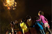 Group of people watching firework display Stock Photo - Premium Royalty-Freenull, Code: 614-07031246