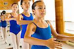 Ballerinas practising at the barre in ballet school Stock Photo - Premium Royalty-Freenull, Code: 614-07031259