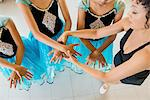 Mature ballet teacher arranging ballerina's hands Stock Photo - Premium Royalty-Freenull, Code: 614-07031267