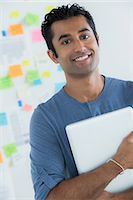 Portrait of male office worker holding digital tablet Stock Photo - Premium Royalty-Freenull, Code: 614-07031385