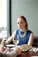 Young woman in restaurant Stock Photo - Premium Royalty-Freenull, Code: 614-07031524