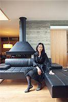 Mature woman sitting on sofa, portrait Stock Photo - Premium Royalty-Freenull, Code: 614-07031582