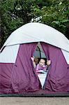 Toddler twins and father peeking out of tent Stock Photo - Premium Royalty-Free, Artist: ableimages, Code: 614-07031803