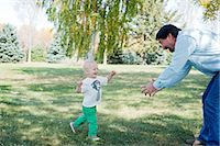 Grandfather playing with grandson in park Stock Photo - Premium Royalty-Freenull, Code: 614-07031841