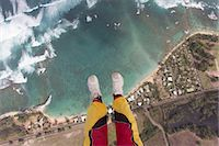 people falling - Legs and feet of skydiver above coastline Stock Photo - Premium Royalty-Freenull, Code: 614-07031894
