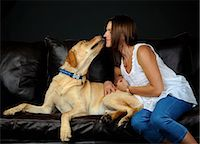 Portrait of labrador retriever and owner on sofa Stock Photo - Premium Royalty-Freenull, Code: 614-07031956