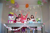 Girls cheering at birthday party Stock Photo - Premium Royalty-Freenull, Code: 614-07032030