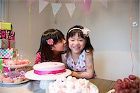 preteen kissing - Girl kissing friend at birthday party Stock Photo - Premium Royalty-Freenull, Code: 614-07032047
