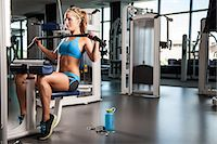 Woman pulling weights Stock Photo - Premium Royalty-Freenull, Code: 614-07032163