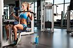 Woman pulling weights