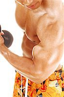A closeup of the chest and biceps of a young bodybuilder holding up a dumbbell for white background. Stock Photo - Royalty-Freenull, Code: 400-07036765