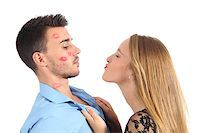 Woman trying to kiss a man desperately isolated on a white background Stock Photo - Royalty-Freenull, Code: 400-07044666