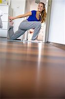 Young woman stretching and exercising at home Stock Photo - Premium Royalty-Freenull, Code: 649-07063022
