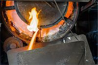 extremism - Close up of machinery and molten metal in steel foundry Stock Photo - Premium Royalty-Freenull, Code: 649-07063065