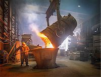 extremism - Steel worker and buckets of molten metal in steel foundry Stock Photo - Premium Royalty-Freenull, Code: 649-07063084