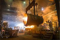 extremism - Steel worker and bucket of molten metal in steel foundry Stock Photo - Premium Royalty-Freenull, Code: 649-07063085