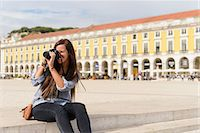 Young female tourist photographing in Rossio Square, Lisbon, Portugal Stock Photo - Premium Royalty-Freenull, Code: 649-07063184