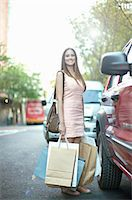 Young woman with shopping bags next to car Stock Photo - Premium Royalty-Freenull, Code: 649-07063270
