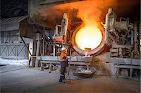 extremism - Worker raking liquid aluminum from furnace at recycling plant Stock Photo - Premium Royalty-Freenull, Code: 649-07063384