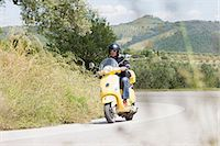 road landscape - Man on scooter riding around corner Stock Photo - Premium Royalty-Freenull, Code: 649-07063504
