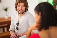 flirting - Young couple talking in cafe Stock Photo - Premium Royalty-Freenull, Code: 649-07063524
