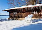 Snow covered log cabin, Lake Starnberg, Bavaria, Germany