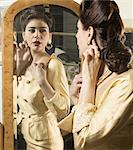Close up of woman in vintage clothes looking in mirror